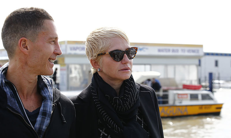 US actors Ellen Barkin (R) and Gabriel Byrne arrive  at Marco Polo Airport in Venice to take a taxi boat for wedding of George Clooney and Amal Alamuddin. -Photo by AFP