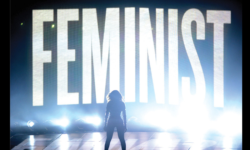 Beyoncé singing with the word FEMINIST emblazoned behind her at the 2014 MTV Video Music Awards in Inglewood, California.