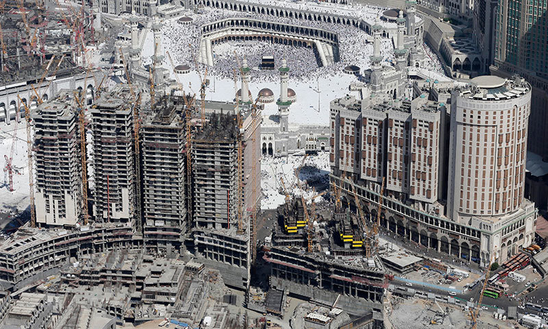 Nov. 17, 2010 file aerial image made from a helicopter shows Muslim pilgrims moving around the Kaaba, the black cube seen at center, inside the Grand Mosque, during the annual Hajj in Makkah, Saudi Arabia. — Photo by AP