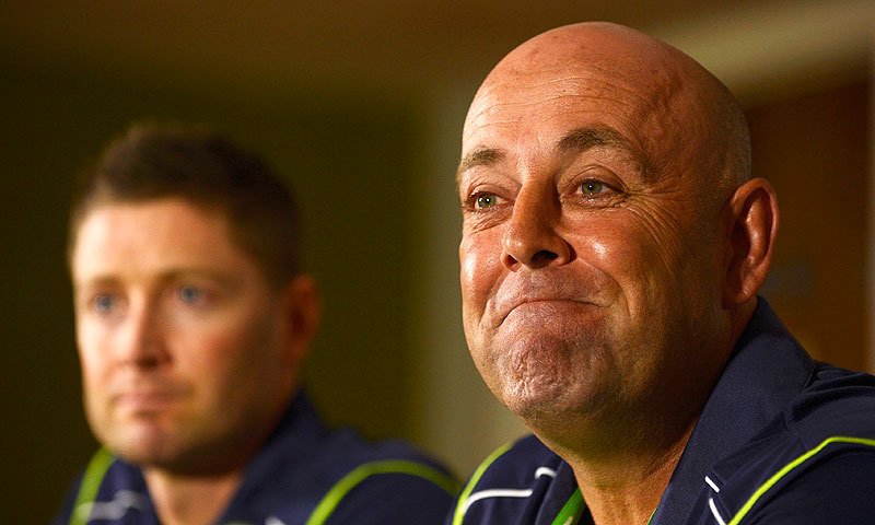 Darren Lehmann speaks during a press conference with Michael Clarke. – Photo by AFP/File