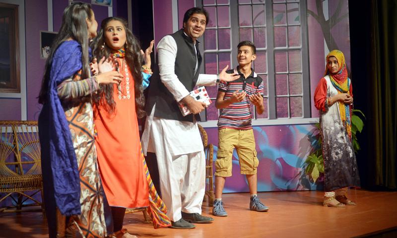 Azam (Muhammad Farhan, in the middle) reacts to Bobby's (Muhammad Anas left) remark as Huma (Kiran Shayari, extreme left), Sumbul (Aza Shamsi) and Nusrat (Kanwal Fatima) look on.—White Star