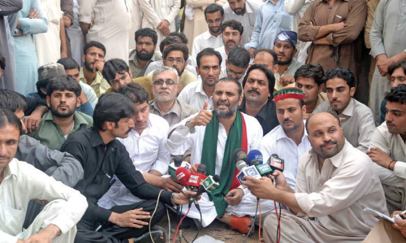 MPA Javed Naseem addresses a press conference at a park outside  Peshawar Press Club on Saturday. — White Star