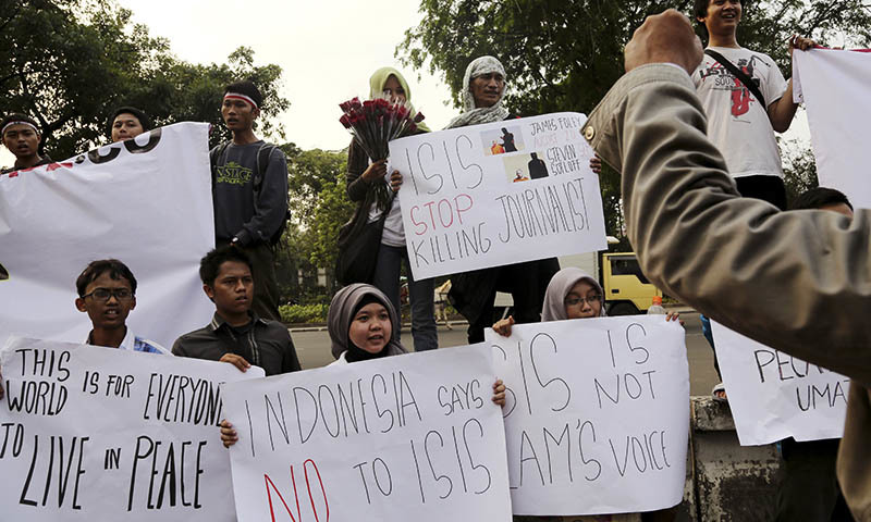 In this Sept. 5, 2014 photo, protesters hold posters during a rally against the Islamic State group, in Jakarta, Indonesia. — Photo by AP