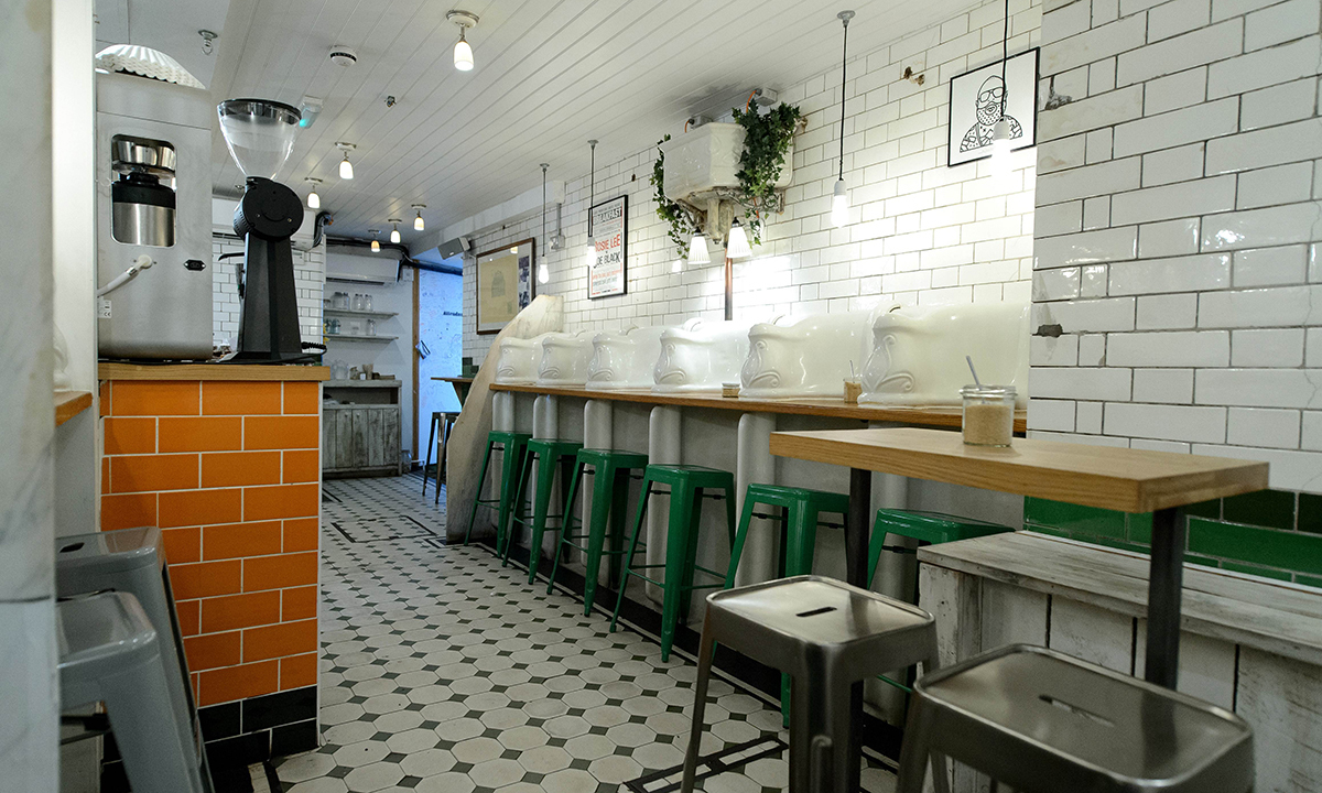 "Original urinals and cisterns are pictured in ""Attendant"", a former public toilet that has been converted into a coffee shop and sandwich bar in central London. — Photo by AFP"