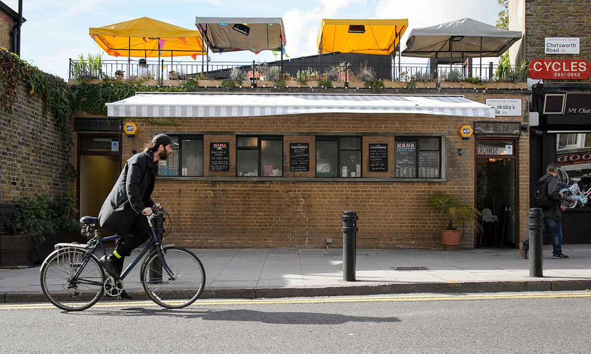 "A man cycles past ""The Convenience"", a former public toilet that has been converted into a coffee shop and restaurant in Hackney, east London. — Photo by AFP"