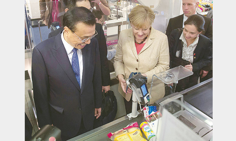 Li, Merkel set aside differences, eye deals worth $2.5bn