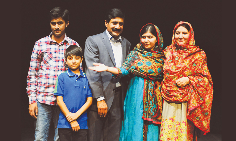 BIRMINGHAM: Malala Yousufzai pictured with mother Tor Pekai (right), brothers Khushal (left) and Atal, and father Ziauddin here on Friday.—AFP