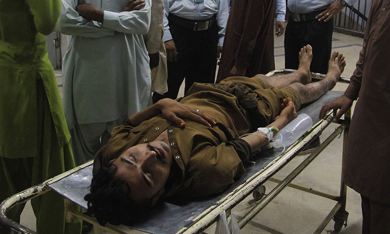 Photo shows a stampede victim at a hospital following the Pakistan Tehreek-i-Insaf (PTI) rally in Multan on October 10, 2014.—AFP photo