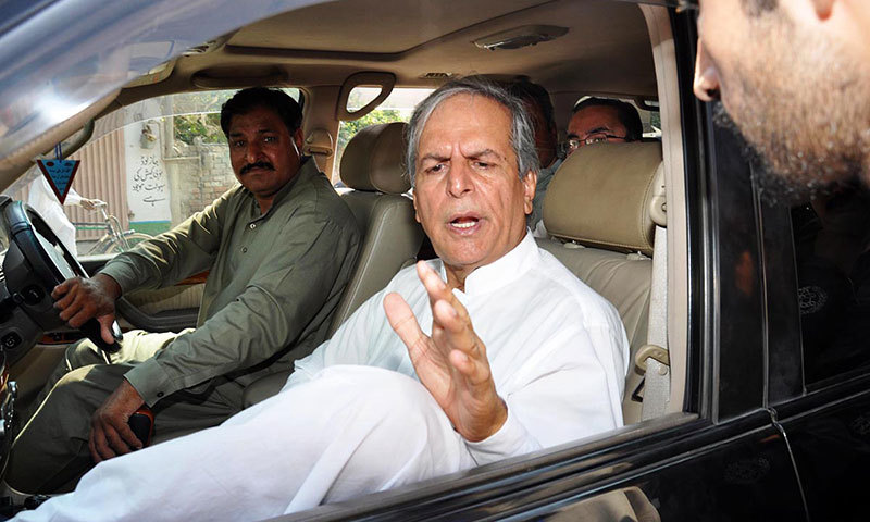 Independent candidate Javed Hashmi is seen in his car during his visit at a polling station during by-elections for NA-149 in Multan on Thursday. – Photo by Online