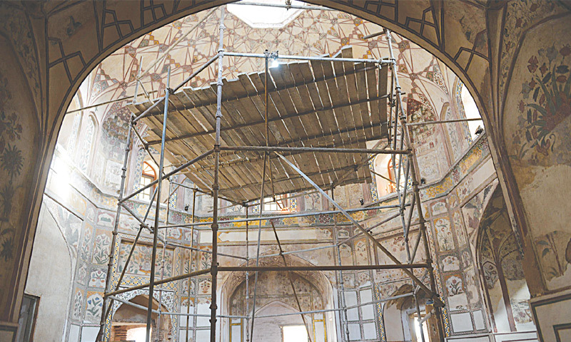 SCAFFOLDING poles cover a portion of the Shahi Hammam, located near the Delhi Gate in the walled city, Lahore. It is currently undergoing restoration work by the Aga Khan Trust for Culture.—Arif Ali / White Star