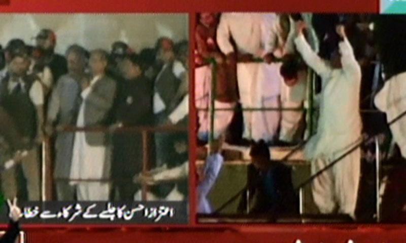 – Screen grab shows Aitzaz Ahsan addressing the Karachi jalsa while Asif Ali Zardari waving at crowd