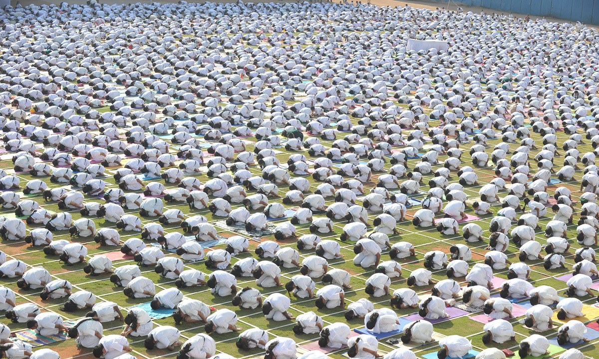 Indian students of Delhi Public School perform yoga during a mass session in Hyderabad. Photo-by-AFP
