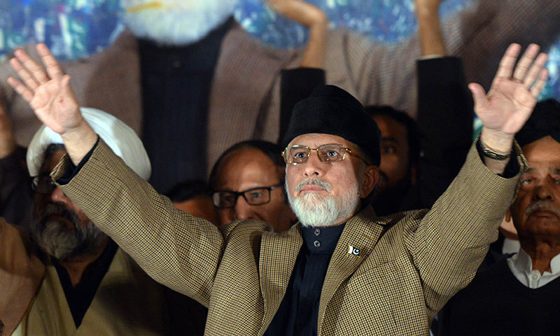 Tahir ul Qadri waves to supporters. – AFP Photo
