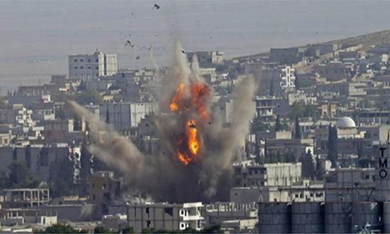 Kobani under attack. —Photo courtesy of Tolga Bozoglu Epa/Landov