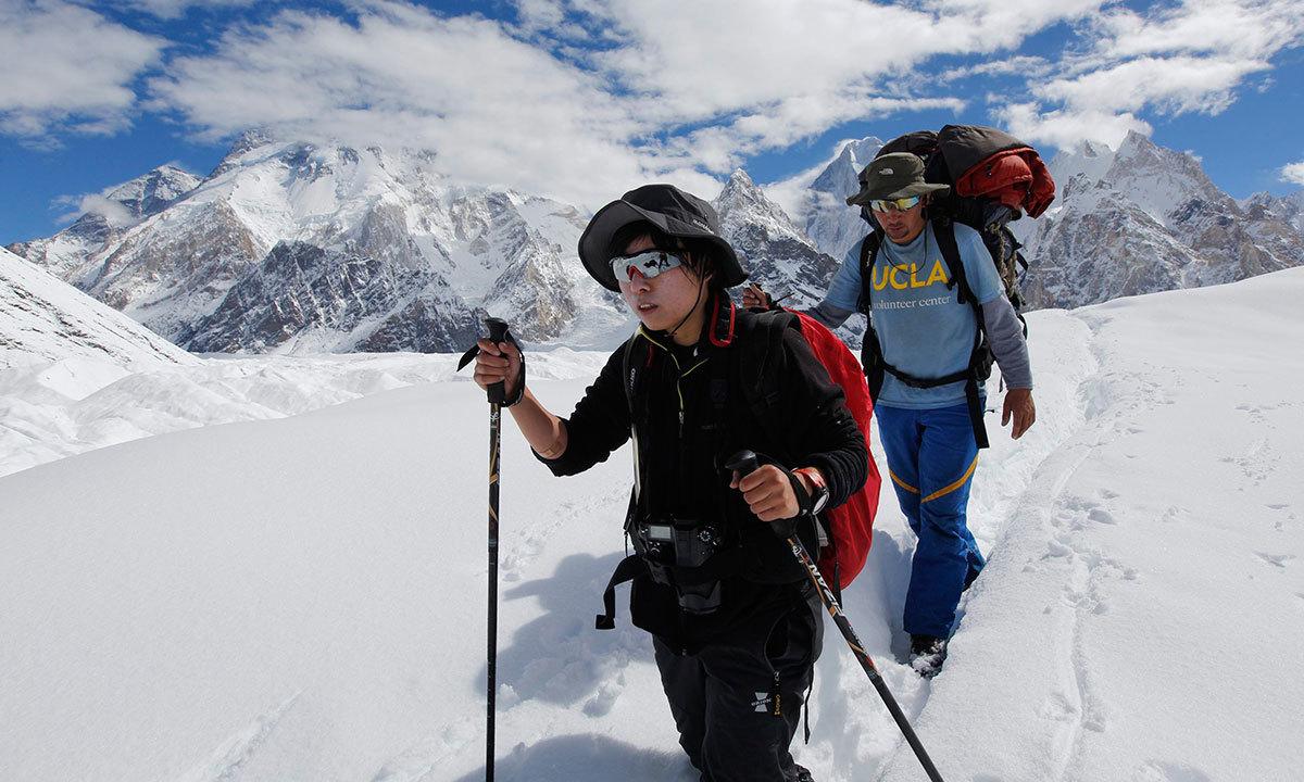 A porter guides his trekking client down the Baltoro glacier in the Karakoram mountain range in Pakistan. -Reuters Photo