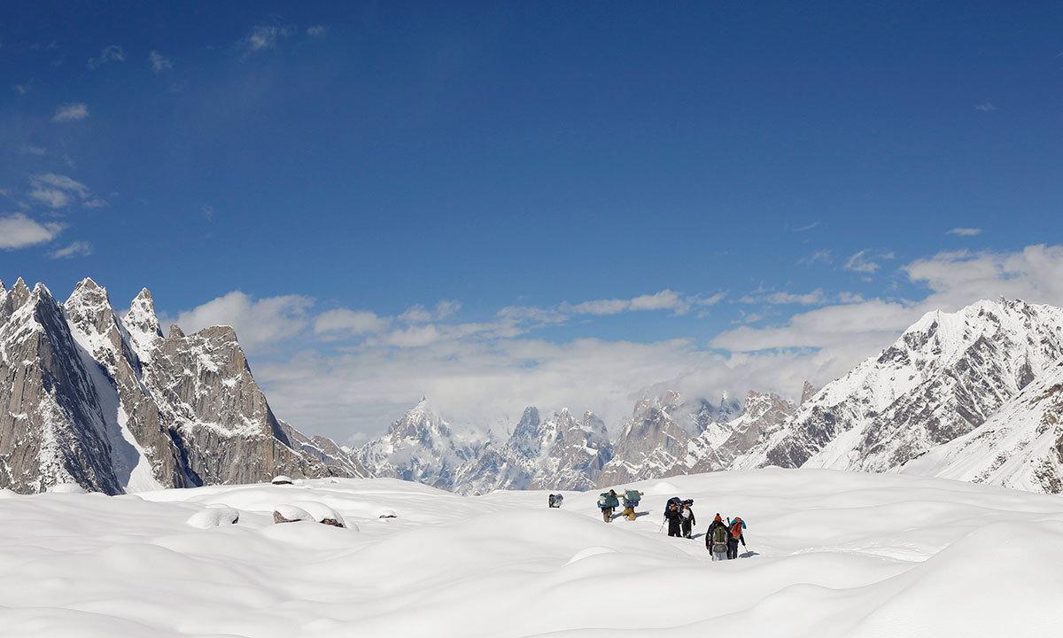 Trekkers and porters hike down the Baltoro glacier in the Karakoram mountain range in Pakistan. -Reuters Photo