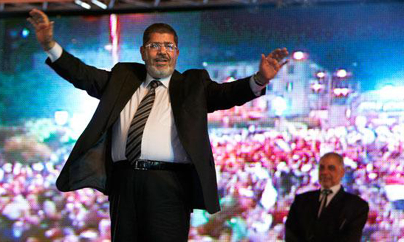 Post-Cold War Islamism triumphed at the polls but failed at governance. Muhammad Morsi, a member of Egypt's Muslim Brotherhood, was elected President of Egypt in 2012. Within a year he fell from grace as millions of his opponents took to the streets demanding his resignation. He was ousted in a military coup in July 2013.