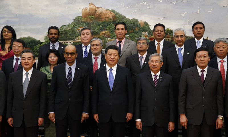 Beijing: President Xi Jinping (C) with guests of the Asian Infrastructure Investment Bank at the Great Hall on Friday.—AFP