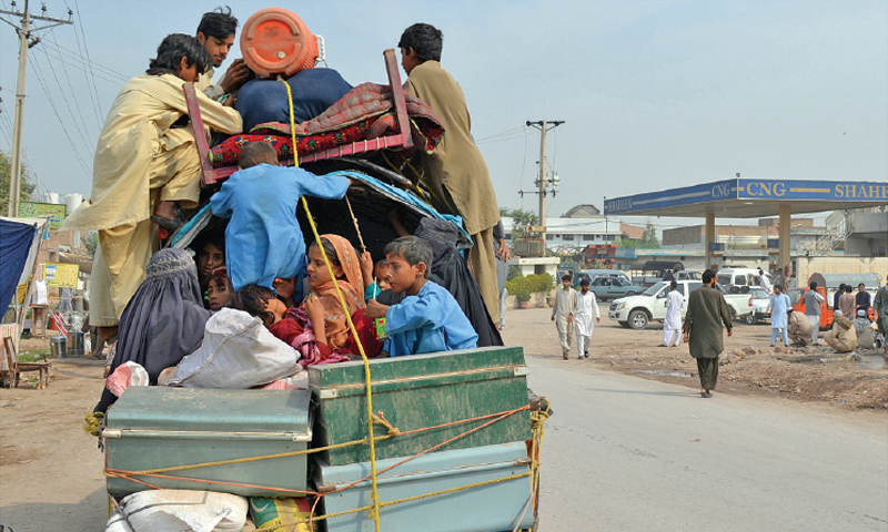 A FAMILY leaves Bara in wake of a military operation in the area. — Dawn