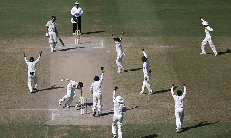 Pakistani players appeal to the umpire for dismissal of  Steve Smith during day five of the First Test between Pakistan and Australia at Dubai International Stadium in United Arab Emirates. — Photo by AP