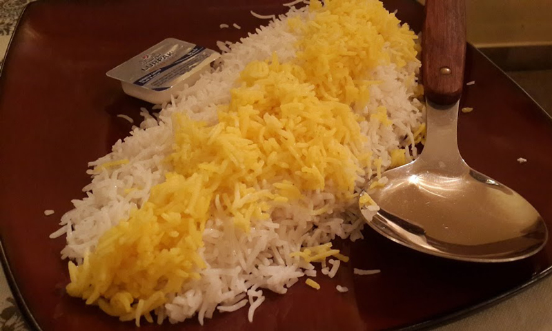 Zafrani rice served with butter on the side. — Photo by author.