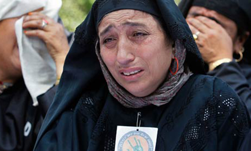Kashmiri women, who say their relatives are missing, cry during a demonstration organised by the Association of Parents of Disappeared Persons (APDP).—Reuters file photo