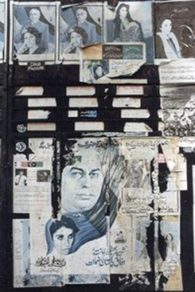 A wall in Karachi covered with MRD and PPP posters during the 1981 MRD Movement.