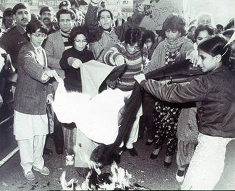 Women activists burn their dupattas in Karachi to protest against what they believed were Zia's 'anti-women laws' (1983).