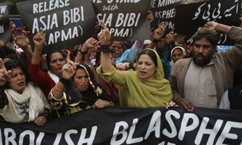 Protesters hold up placards while demanding the release of Asia Bibi. – Reuters Photo/File