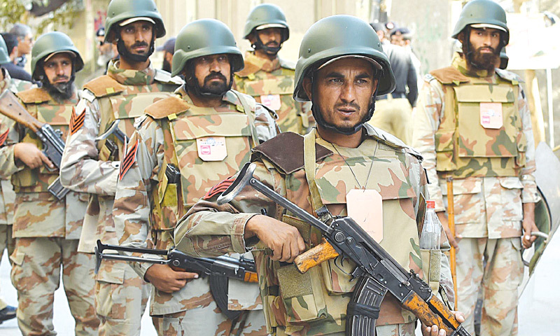 QUETTA: Paramilitary soldiers on alert during a Muharram procession here on Saturday.—AFP
