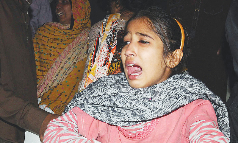 A GIRL mourns after victims of the explosion were brought to a hospital.—AFP