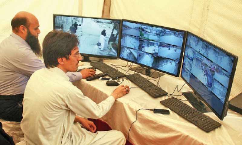 Security personnel monitor routes ahead of Muharram processions in Peshawar on CCTV cameras. —Online