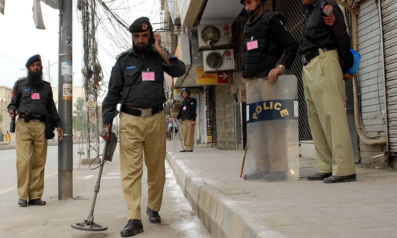 BDS staff busy in searching to give security clearance on the occasion of Ashura, in Peshawar. - PPI