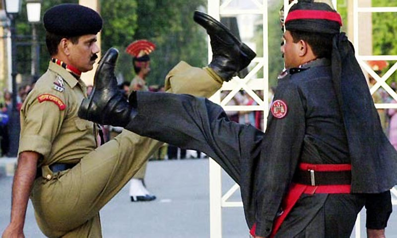 In this photograph taken on May 24, 2003, A Pakistani (R) and an India soldier march during the flag-lowering ceremony at The Wagah Border Post. — AFP/File