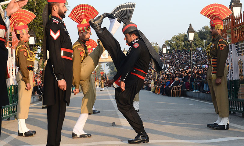 Punjab Rangers (in Black) and Indian Border Security Force personnel (in Brown) perform the 'flag off' ceremony at the Pakistan-India Wagah Border Post. — AFP/File