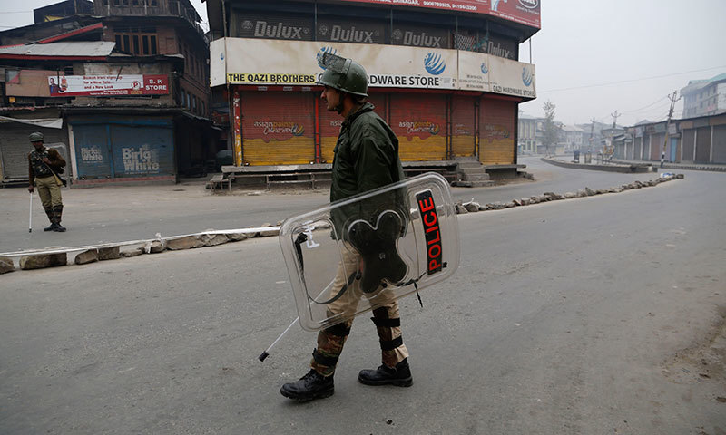 Indian paramilitary soldiers patrol a street during curfew in Srinagar, Nov 4, 2014. - AP