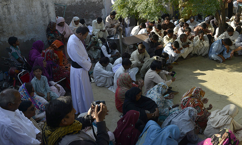Christians gather and pray for the murdered Christian couple in Kot Radha Kishan - AFP