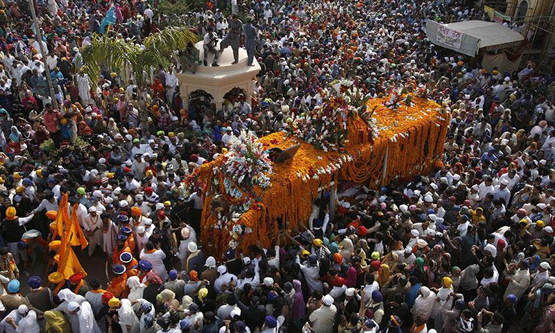 Sikh pilgrims take part in a religious procession to mark the birth anniversary of Guru Nanak Dev Ji, the founder of Sikhism, in Nankana Sahib, 90 km  from Lahore November 6, 2014. - Reuters