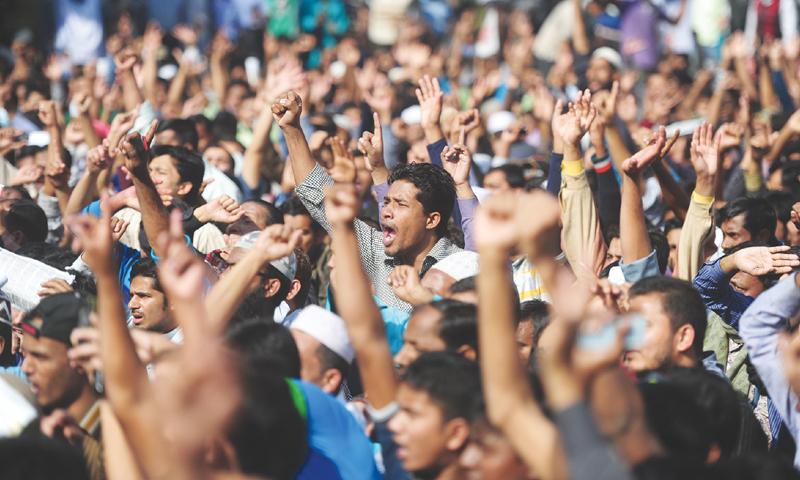 ACTIVISTS of Jamaat-i-Islami at a rally last year in Dhaka.—AFP