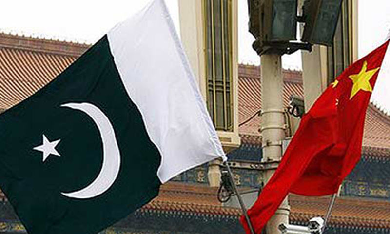 A Pakistan national flag flies alongside a Chinese national flag in front of the portrait of Chairman Mao Zedong on Beijing's Tiananmen Square. — Reuters/File