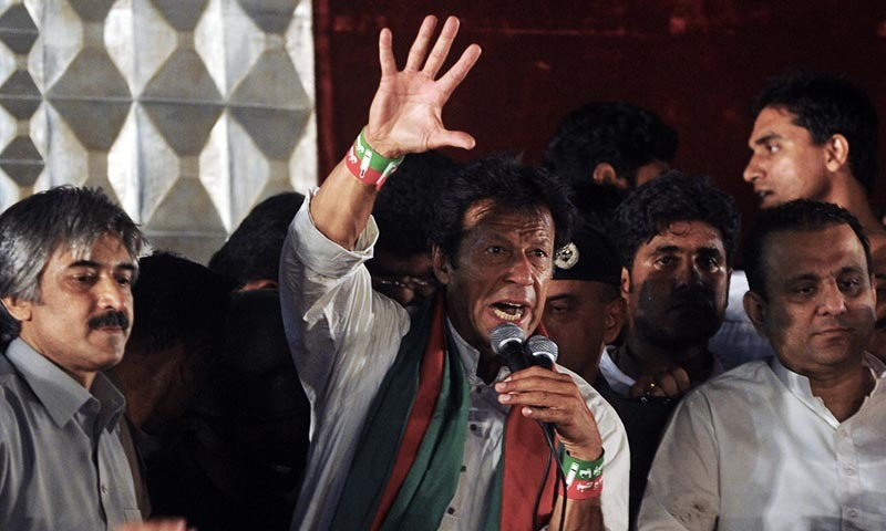 Chairman of Pakistan Tehreek-i-Insaf (PTI) Imran Khan addresses the party workers and supporters. -AFP/file