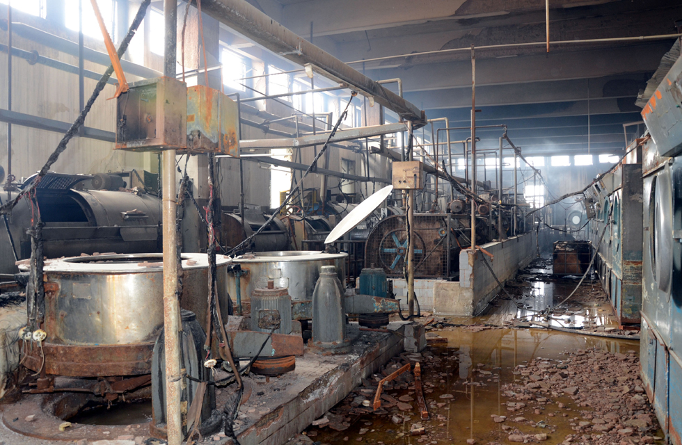Damaged machinery inside the factory indicates the magnitude of the fire at Ali Enterprises. Photo by White Star