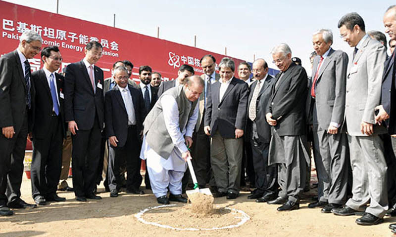 A handout picture released by Pakistan's Press Information Department (PID) shows Pakistan's Prime Minister Nawaz Sharif (C) attending a ceremony launching the construction of an atomic power plant at Paradise Beach, 40 kms west of Karachi, on November 26, 2013. - AFP/file