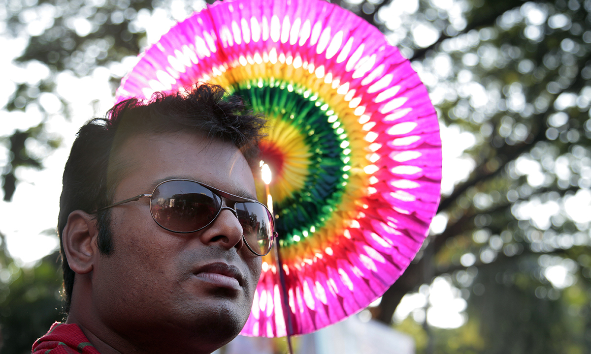 A participant holds a colorful hand fan at the rally.— AP Photo