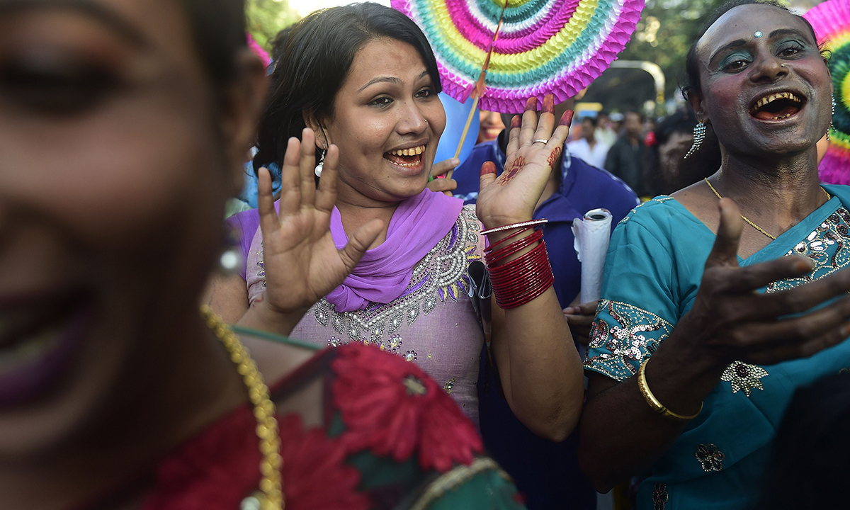 Bangladeshi transgenders dance at the rally.— AFP Photo