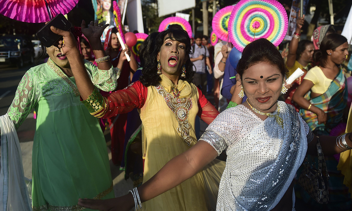Transgenders dance in the street.— AFP Photo