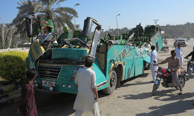 A passenger bus with its roof ripped off the main body is pictured after the accident in Khairpur, 450 kilometres (300 miles) north of Karachi, on November 11, 2014. - AFP/file photo