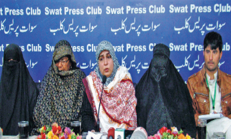 Amina Masood Janjua addresses a press conference in Mingora on Wednesday. — Dawn