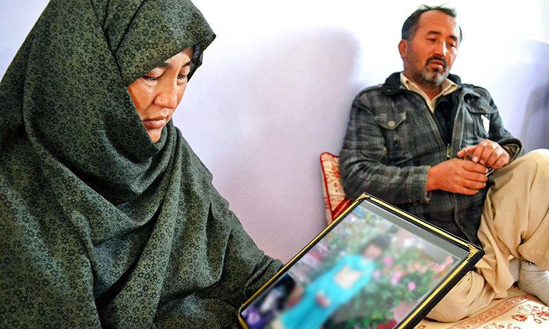The parents of six-year-old Sahar Batool. -AFP