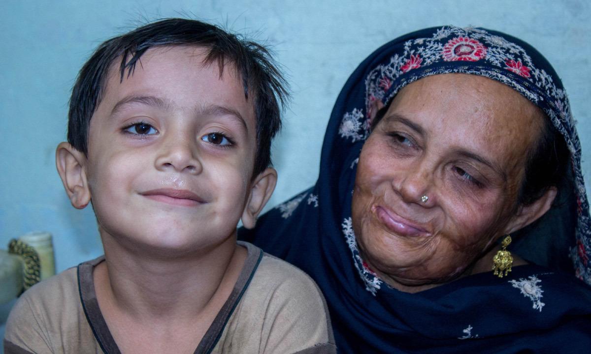 Najma with her grandson. -Photo by Muhammad Umar